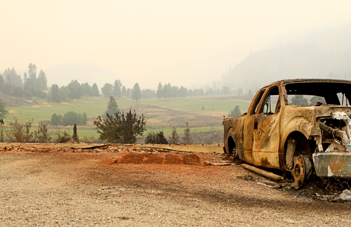 A burned out truck sits in the forefront of the Alta Lake Golf course - torched by the Carlton Complex Fire.