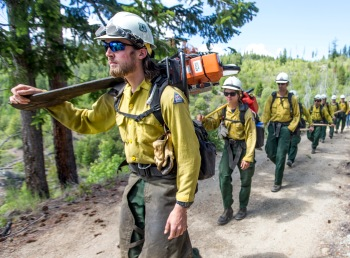 Bennett Murch leads a group of Entiat Hotshot firefighters out to an area on Tyee Mountain to cut a fire line on May 31, 2016.
