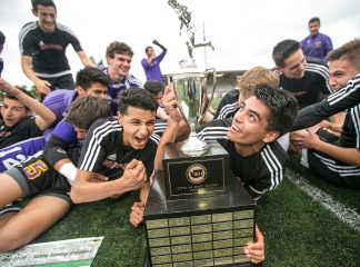 The Wenatchee Panther soccer team celebrates with their first place trophy after winning, 1-0, over Mt. Tahoma High School in the WIAA state 4A/3A/2A championship game on May 28, 2016.