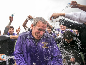 The Wenatchee Panther soccer team dumps water on head coach Dennis Tronson in celebration after after winning, 1-0, in the WIAA state 4A/3A/2A championship game on May 28, 2016.