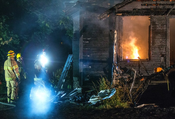 Firefighters extinguish a house fire in the 1900 block of Lower Monitor Road in Monitor, Washington on Sunday, July 24. No one was injured in the blaze.