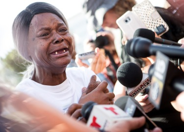 Dalvin Hollins' grandmother is overcome with emotion while speaking to members of the media before a police-violence protest on the Mill Avenue Bridge on Monday, Sept. 26, 2016 in Tempe, Arizona. Hollins died in an incident with the Tempe Police Department in July.