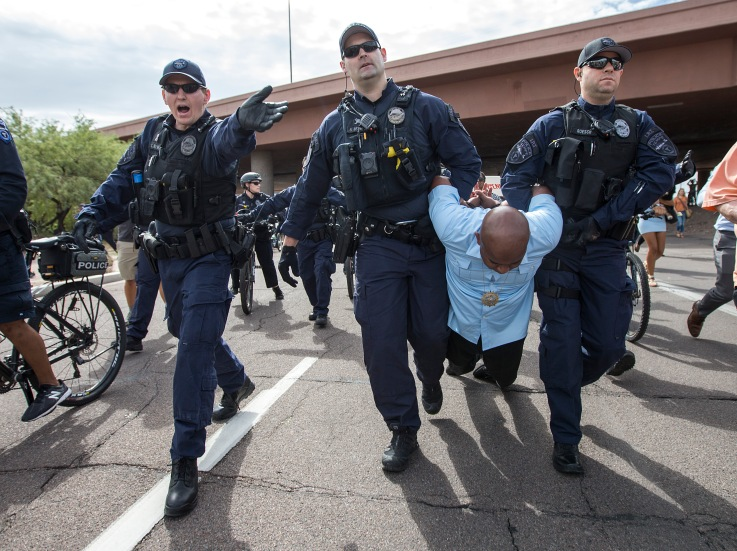 Rev. Jarrett Maupin is arrested during a police-violence protest on the Mill Avenue Bridge on Monday, Sept. 26, 2016 in Tempe, Arizona. Maupin was one of a few people arrested during the rally.