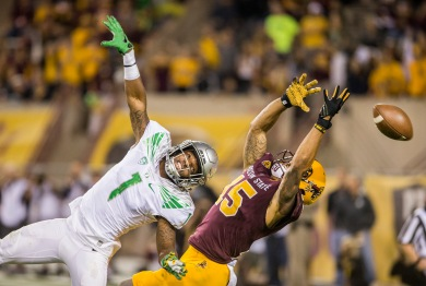 Oregon cornerback Arrion Springs, left, looks to intercept a throw intended for Arizona State University redshirt senior wide receiver Devin Lucien, right, on Thursday, Oct. 29, 2015, in Tempe, Arizona. The Oregon Ducks narrowly beat the Arizona State Sun Devils, 61-55, in a triple-overtime PAC-12 game.