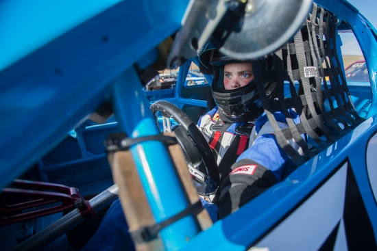 Dale Wennerberg, 12, sits in his No. 73 racecar before the Youth Tuner qualifying lap at the Wenatchee Valley Super Oval in East Wenatchee, Washington on Saturday, June 20, 2015.