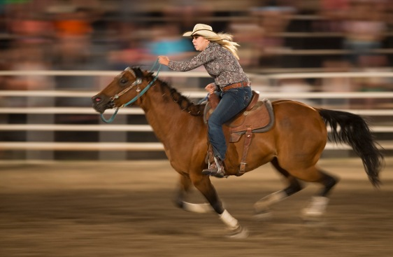 Barrel Racer Tanisha Lovins of La Grande, Oregon, rides her horse down the final stretch of her event at the Lake Chelan Rodeo in Chelan, Washington.
