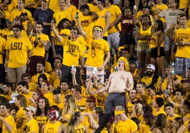 Students in the ASU student section cheer on the Sun Devils during a game against visiting Cal Poly at Sun Devil Stadium in Tempe on Saturday, Sept. 12, 2015. ASU beat Cal Poly 35-21 in its season opener.