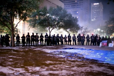 Riot police from the Phoenix Police Department line up outside President Donald Trump's rally in Phoenix on August 22, 2017.