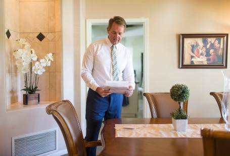Senator Jeff Flake, R-Arizona, looks through letters in his home in Mesa, Arizona on Nov. 5, 2017. Flake, an outspoken critic of President Donald Trump, said he received an outpouring of supportive letters after his October announcement that he will not seek reelection.